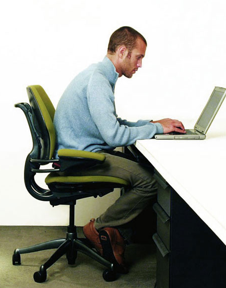 man slouching at the desk